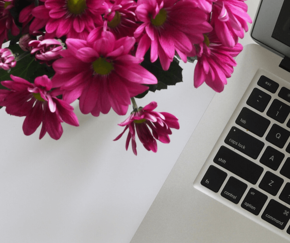 Spring flowers next to laptop